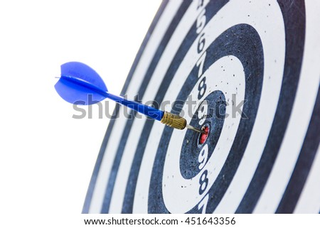 Blue dart arrow on center of dartboard.
