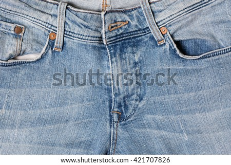 Blue denim jeans close up background - stock photo