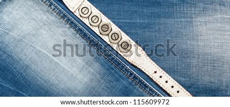 Blue denim jeans texture with leather bracelet - stock photo