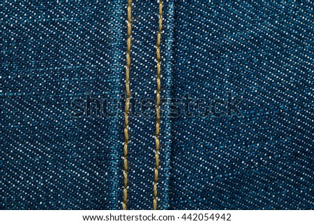Blue denim jeans texture with seam - stock photo