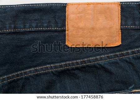 Blue Denim jeans with label used as a background - stock photo