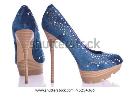 Blue denim shoes, isolated on white - stock photo