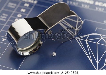Blue Diamond Grading Chart with Diamonds and Loupe. - stock photo