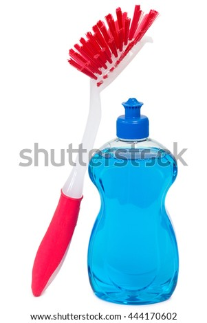 Blue dish washing detergent with red brush over white background