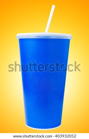 Blue disposable cup close up on yellow background - stock photo