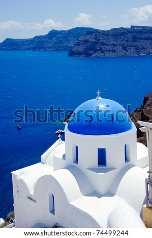 Blue dome churches over the mediterranean sea in oia santorini island,greek - stock photo
