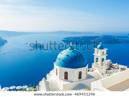 Blue dome of white church at Santorini with blue sky, Mediterranean sea