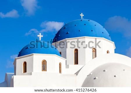 Blue Domes of Orthodox White Church in Perissa, Santorini island, Greece - stock photo