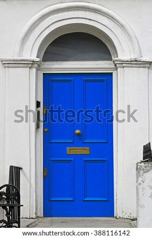 Blue Door House Entrance With Arch