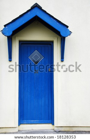 Blue door white plastered wall - stock photo