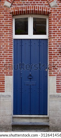 blue door with white windows above in Dutch tradition