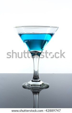 blue drink alcohol in a glass on the table