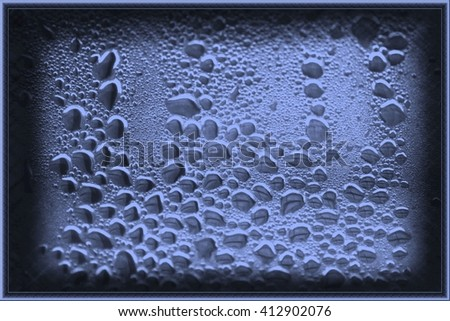 Blue drops on glass