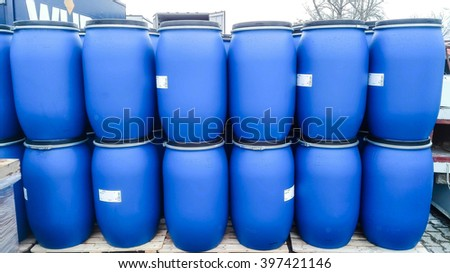Blue drums on a storage site - stock photo