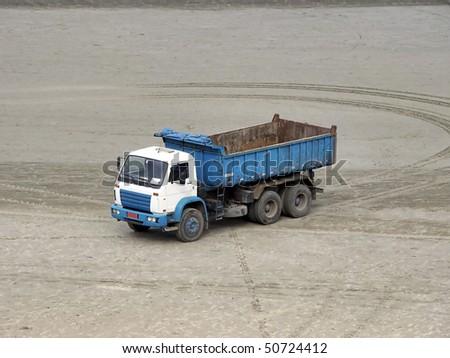 blue dump truck - stock photo