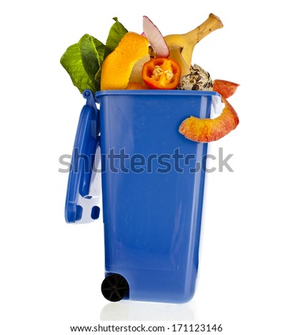 Blue Dumpster filled household waste kitchen scraps  isolated on white background - stock photo