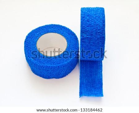 Blue Elastic Medical Bandage on White Background. - stock photo