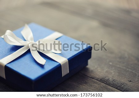 Blue elegant gift box on a wooden background - stock photo