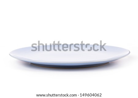 Blue, empty plate, side view, isolated on white background. - stock photo