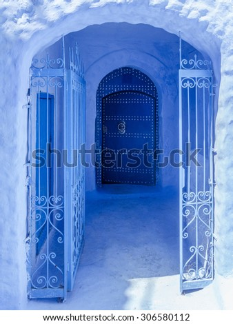 Blue entrance in the medina of Chefchaouen, north of Morocco - stock photo