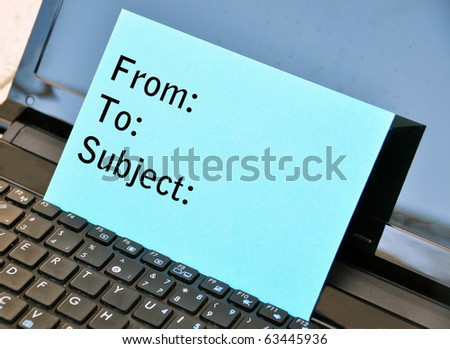 Blue envelop on the laptop - stock photo