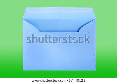 Blue envelope isolated on the green surface with work paths. - stock photo