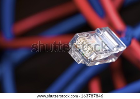 Blue ethernet cable computer and colorful background - stock photo