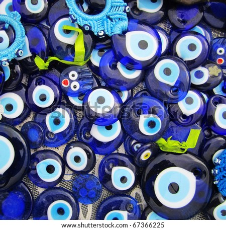 Blue Evil Eye Charms Sold at Bazaar or Market in Turkey - stock photo