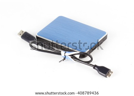 Blue External Hard Drive and cable isolated on white - stock photo