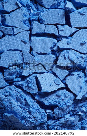Blue eye shadow, crushed cosmetic texture background - stock photo