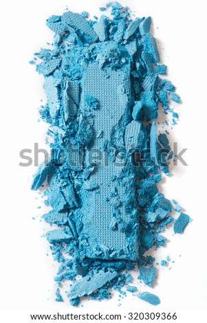Blue eye shadow make up crushed on white - stock photo