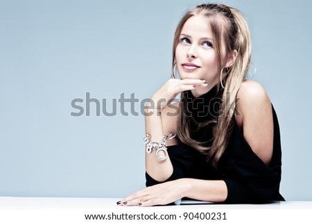blue eyes blond elegant woman portrait, studio shot - stock photo