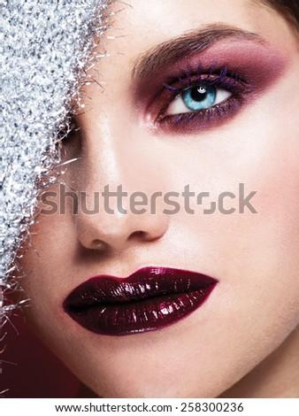 Blue Eyes Closeup.Beautiful Fashion Girl with Arrow Make up. Closeup Female eye with Beautiful Fashion bright makeup  - stock photo