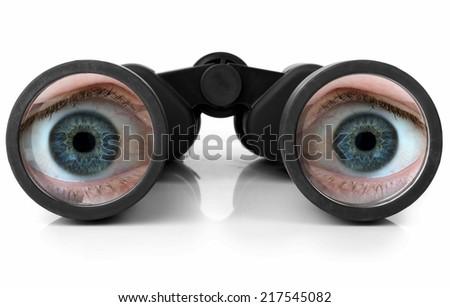 Blue eyes looking through a pair of new binoculars - stock photo