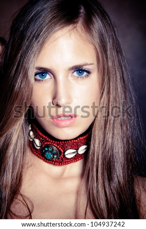 blue eyes young woman portrait wearing necklace made of shells studio shot - stock photo