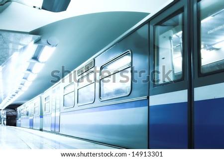Blue fast train stay at hall platform - stock photo