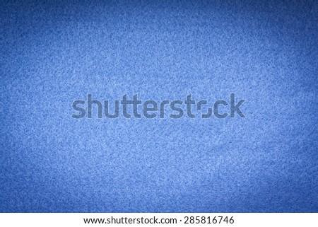 Blue felt background. - stock photo