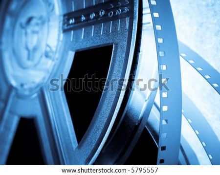 Blue Film reels closeup. Movie industry concept - stock photo