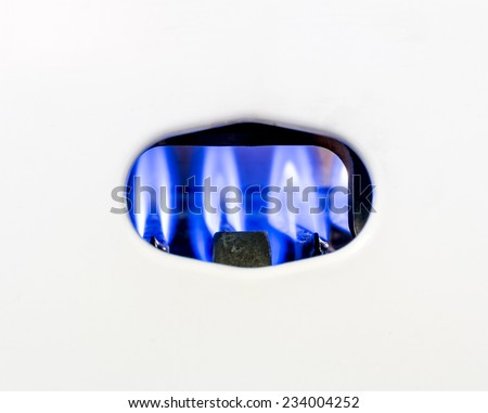 Blue fire burning gas nozzle gas water heater - stock photo