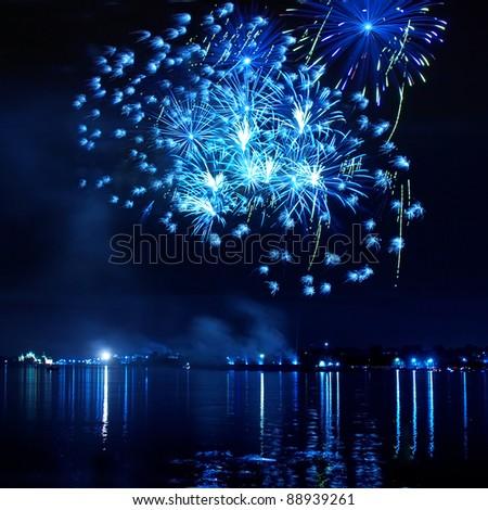 Blue firework in a night sky - stock photo