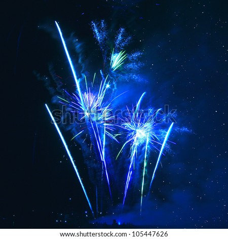 Blue firework in background of night sky - stock photo