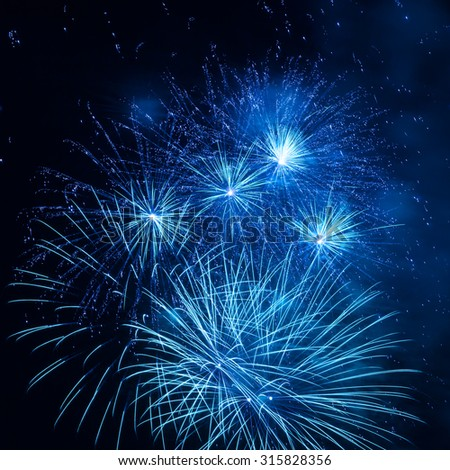 Blue fireworks in the night sky