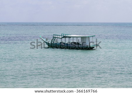 Blue fishing boat floating in the ocean of Koh Samui, Gulf of Thailand
