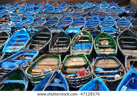 blue fishing boats in port