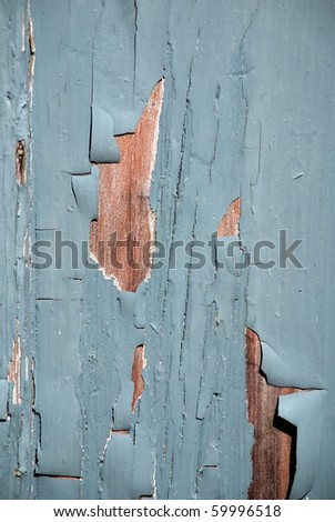 Blue flaky paint on a wood - stock photo