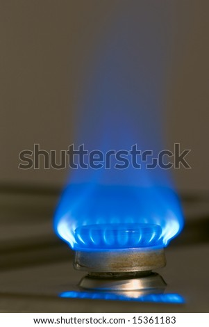 Blue flame of gas burner on kitchen stove - stock photo