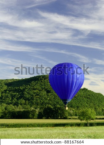 blue flying hot air balloon, hot air ballon - stock photo