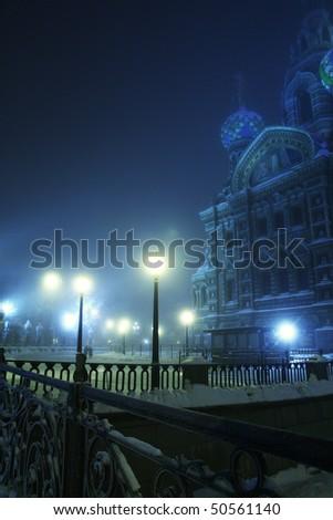 Blue foggy night winter city lights with the Savior-on-blood church (Saint-Petersburg) - stock photo