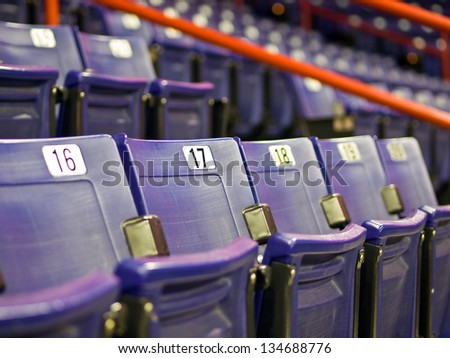 Blue Folding Seats at an Indoor Sports Arena - stock photo