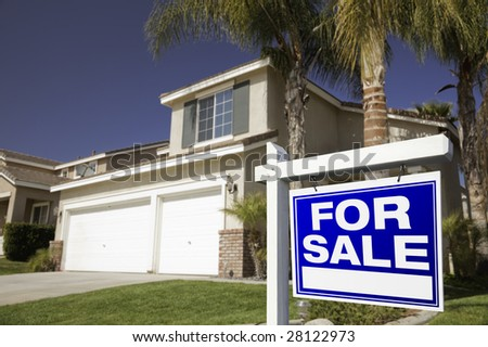 Blue For Sale Real Estate Sign in Front of House. - stock photo